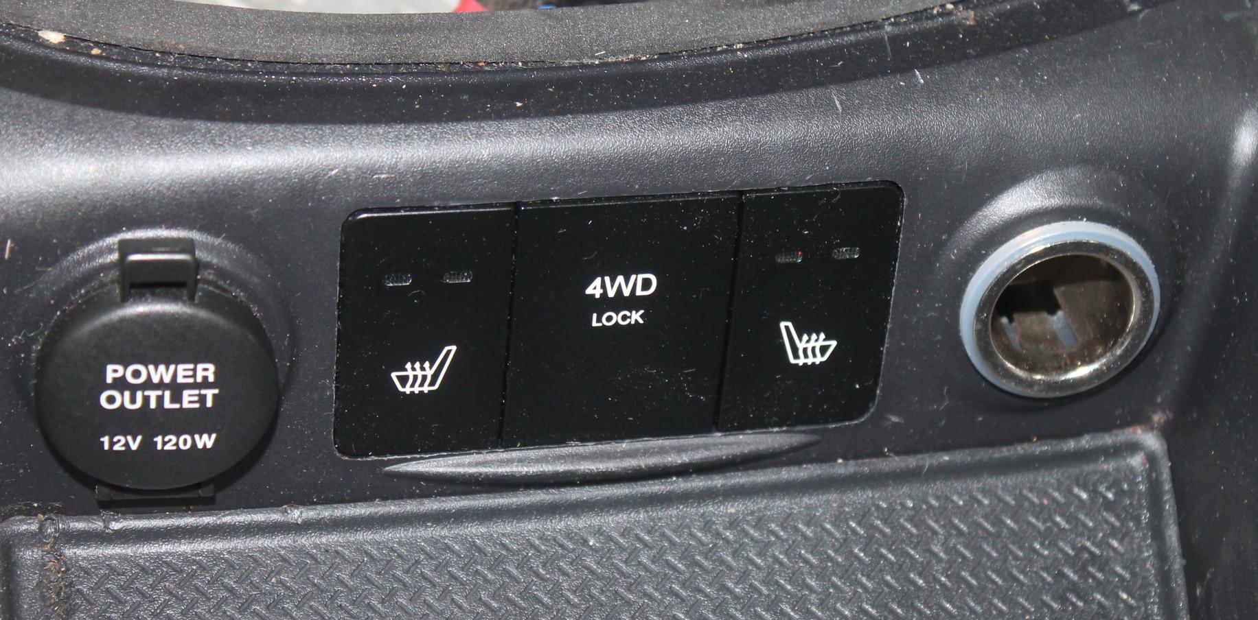 Кнопка обогрева сидений